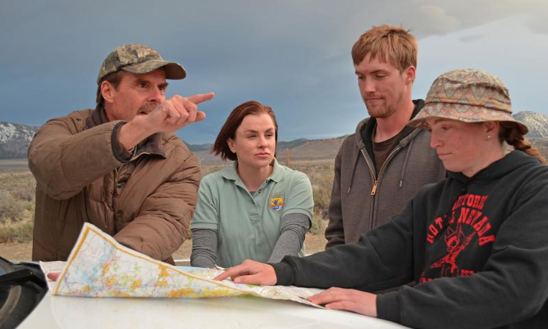 CDFW wildlife biologist Tim Taylor, (From left to right), Erin Nordin, Service wildlife biologist, and Samuel Malone and Mary Meyerpeter, USGS biological science technicians, discuss bi-state greater sage-grouse capturing locations during the Parker Meadows translocation project. Credit: Dan Hottle/USFWS